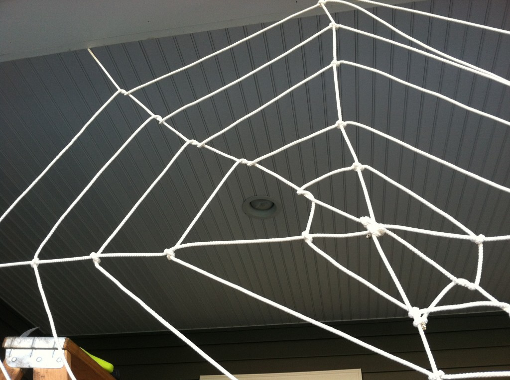 Finishing Touches on DIY Halloween Spider Web