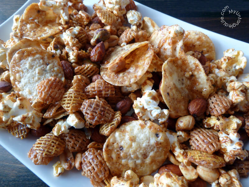 Super Bowl Snack Mix - This snack mix is addictive! It is sweet, salty, and has just a little bit of heat. No matter which team you are cheering for, you will cheer for this mix.