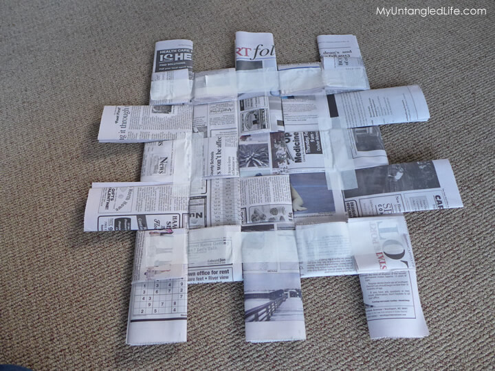 Newspaper pad for sit upon